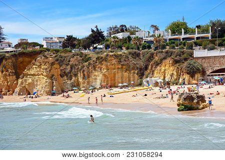 Lagos, Portugal - June 9, 2017 - Tourists Relaxing On Praia Da Batata Beach, Lagos, Algarve, Portuga