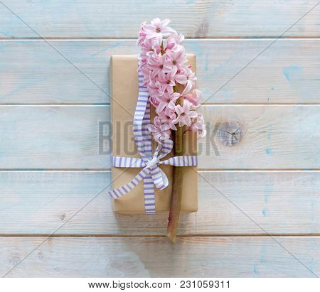 Festive gift box with pink hyacinth flowers