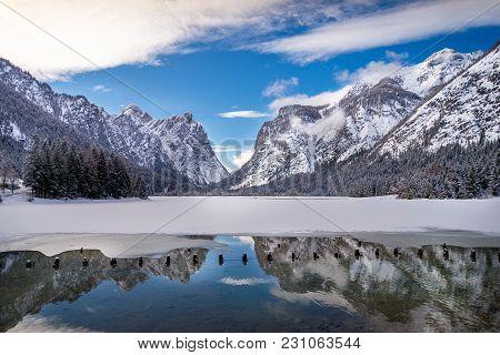 Reflection Of Mountain Peaks In Winter Lake, Dolomites