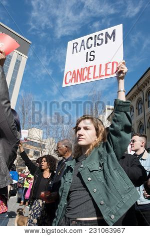 Woman Holding Sign Against Racism