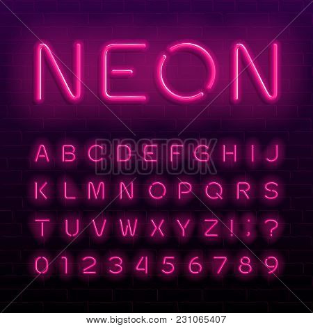 Neon Lamp Alphabet Font. Neon Color Shiny Letters, Numbers And Symbols. Brick Wall Background. Stock