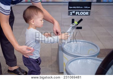 Asian Father Teach Cute Little 18 Months, 1 Year Old Toddler Baby Boy Child Throwing Plastic Bottle