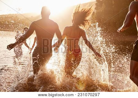 Young adult friends on vacation having fun in a lake
