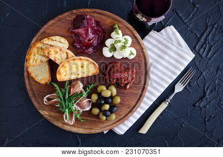 Italian Antipasti Wine Snacks Set. Mozzarella Cheese, Mediterranean Olives, Prosciutto Di Parma, Bre