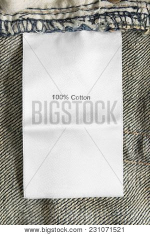 Composition Textile Clothes Label On Beige Cotton Background Closeup