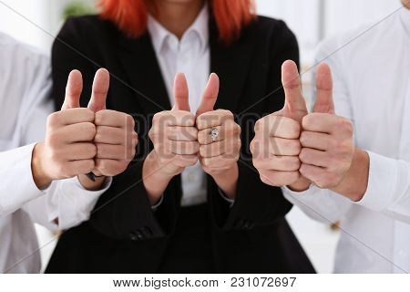 Group Of People Show Ok Or Confirm With Thumb Up During Conference Closeup. High Level Quality Produ