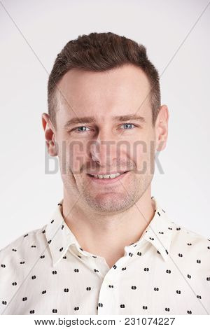 Passport Portrait Of Young Caucasian Man Isolated On White Background