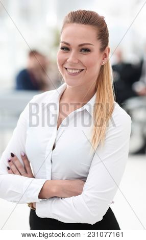 closeup portrait of successful business woman on blurred background office