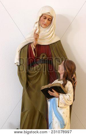 SISAK, CROATIA - DECEMBER 07: Saint Ann with Virgin Mary, statue in the Church of Saint Joseph in Sisak, Croatia, on December 07, 2017.