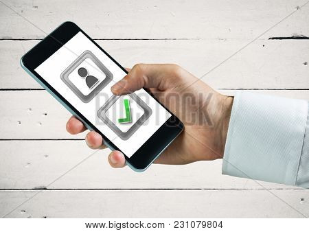 Digital composite of Hand holding phone with user feedback and correct tick button