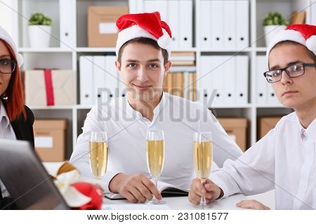 A Group Of Businesspeople Celebrating Christmas New Year Corporate In The Office While Toasting Hold