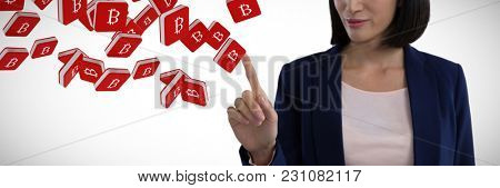 Businesswoman using invisible screen against bit coin symbol