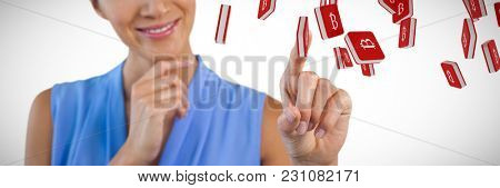 Smiling businesswoman with hand on chin touching interface against bit coin symbol