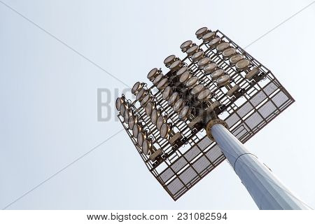 Giant Spotlights Are In The Stadium To The High Pole With Sky Background