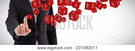 Businesswoman pressing an invisible virtual screen against several red cube with bit coin sign on each side