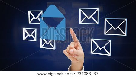 Digital composite of Hand touching 3D email message icons
