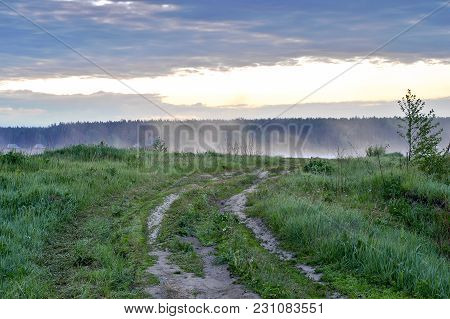 Dirt Road To The Lake In Dawn Mist