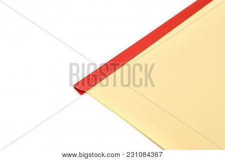 Red Plastic Slide Binder For Document With Yellow Paper Isolated On White Background