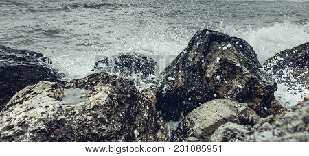 Element Strength Concept. Waves Breaking On The Shore With Sea Foam, Close-up. Nature Travel Adventu