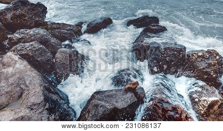 Element Strength Concept. Waves Breaking On The Shore With Sea Foam, Close-up. Nature Travel