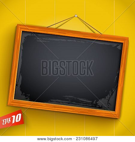 Empty Inclined Chalkboard Hanging On Rope With Wooden Frame On Yellow Background With Vertical Plank