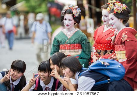Kyoto, Japan - June 10: Unidentified Tourist Women Dress Like A Maiko And Take Photo With Children,