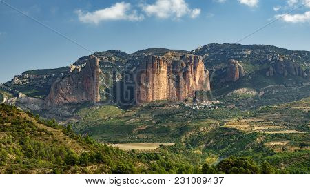 Complete View Of Riglos Mallets And Town With -el Puro-