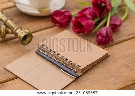 Notepad With Black Pen On Wooden Tabletop