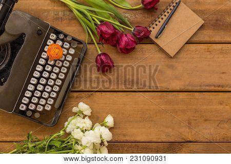 Writer Spring Flat Lay With Purple Tulips, Vintage Camera, Retro Typewriter, White Ranunculus And No