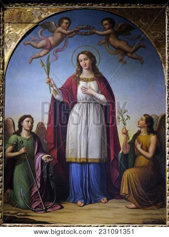 LUCCA, ITALY - JUNE 03: Saint Philomena flanked by two angels by Stefano Lembi, San Michele in Foro church in Lucca, Tuscany, Italy on June 03, 2017