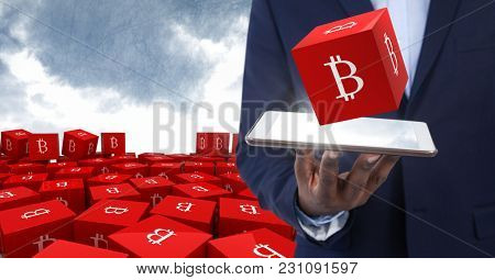 Digital composite of Hand holding tablet with bit coin symbol icons