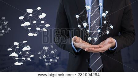 Digital composite of Mixed various app icons connected and Businessman with hands palm open and dark background