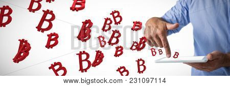 Man using digital tablet against several red bit coin sign