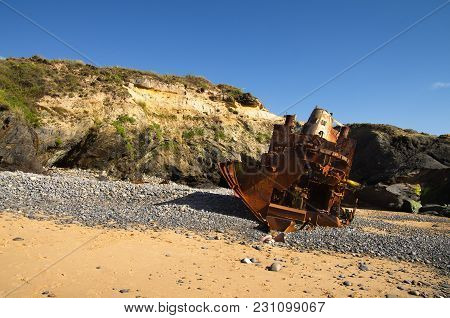 Rear View Of A Pusher Boat Wrecked At An Isolated Beach