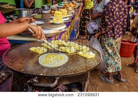 Asian Cook Prepares Traditional Burmese Street Food In Myanmar
