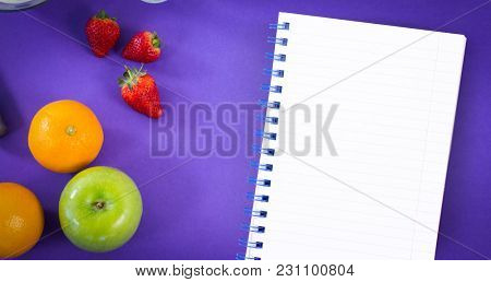 Little Notepad against overhead ciew of various fruits