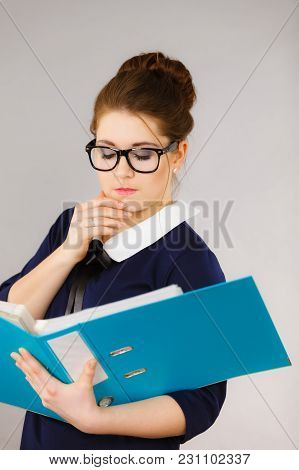 Woman Office Worker Agent Holding Blue File Folder In Hands. Young Elegant Businesswoman Or Secretar