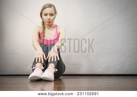 Sad Depressed Young Teenage Girl Sitting By Wall. School, Adolescence, Home Violence, Unwanted Love