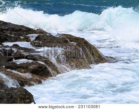 Big Waves On Rock Coast Blue Sea And Sky On Crete, Greece