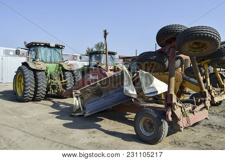 Russia, Temryuk - 15 July 2015: Grader Scheduler. A Retractor With A Grader Trailer