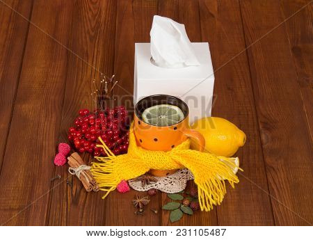 Hot Tea With Lemon From Colds, Warm Scarf, Berries Of Viburnum, On Wooden Table