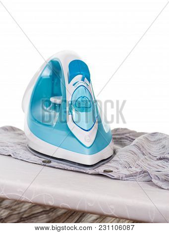 Modern Functional Iron And Linen On Ironing Board, Isolated On White Background