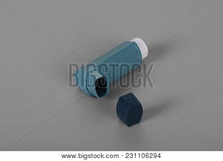 Inhaler Dosing For Asthmatics, On Gray Background