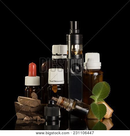 Electronic Cigarette And A Set Of Liquids For Smoking, Sweets, Isolated On Black Background
