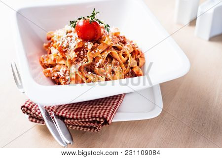 Homemade Ragout Bolognese With Pasta Taglietelle. Bolognese Sauce Is Made With Minced Pork And Beef