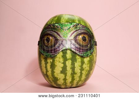 Freak Watermelon Wearing A Snake Sleep Mask A Pink Background