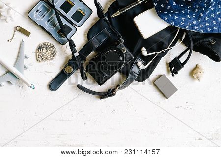 Flat Lay Top View Of Female Photogarpher Summer Holiday Travel Backpack Stuffs With  Digital Camera,