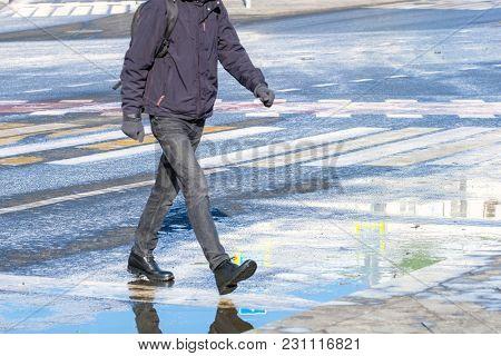 Pedestrians cross the road
