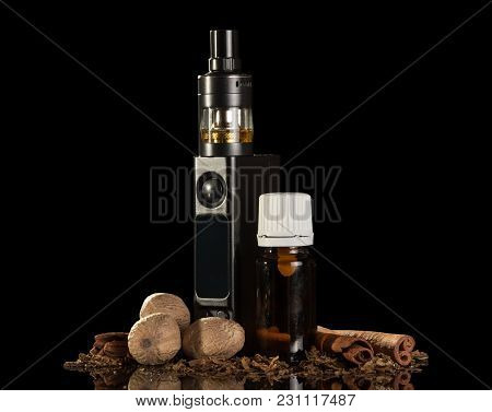 Electronic Cigarette And Crumbs Of Tobacco, Liquid For Smoking, Spices, Isolated On A Black Backgrou