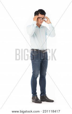 Full Length Portrait Of Young Asian Man Suffering From Headache Isolated On White